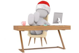At desk considering Christmas buying
