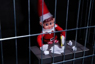 Pounland naughty elf behind bars