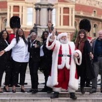 Stars of this year's Royal Albert Hall Christmas season, including Father Christmas, Clive Anderson, the Welsh Guards and the London Community Gospel Choir, gather outside the venue to launch the programme. Credit: Andy Paradise/Royal Albert Hall.