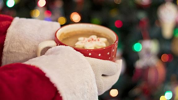 Santa holding hot chocolate