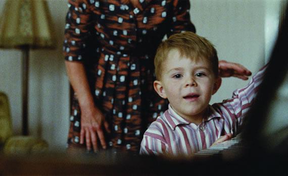 Elton John receives the piano