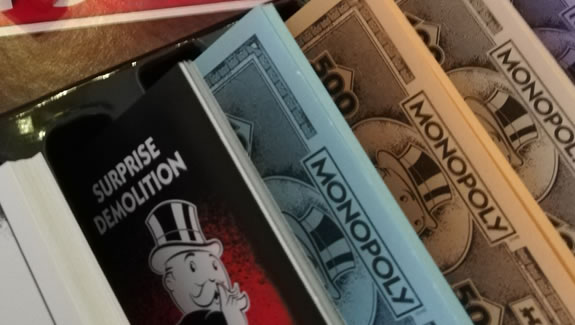 Image of Monopoly Cheaters Edition board game money bank