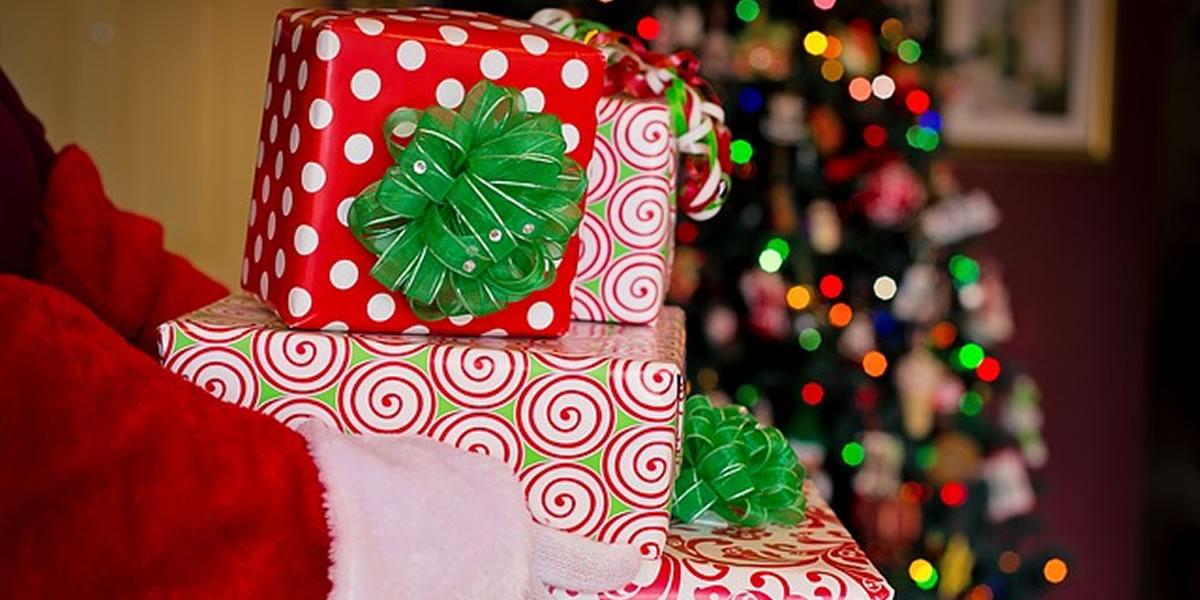 Image of santa carrying Christmas presents