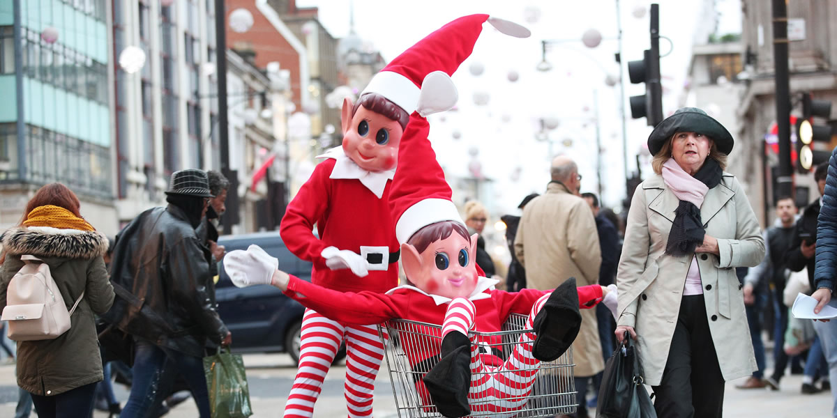 Image of elves behavin badly with shopping trolley