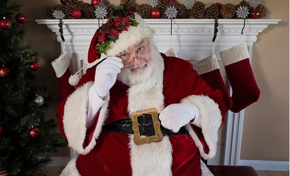 Santa looking through his glasses
