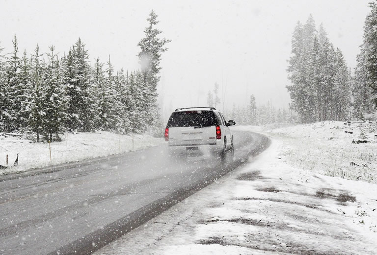 Car travelling in the snow